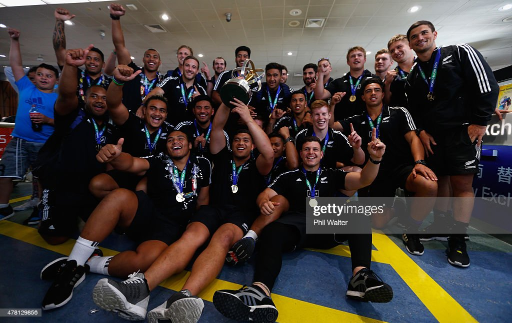 The New Zealand U20 rugby team pose for a group photo at Auckland International Airport on June 23, 2015 in Auckland, New Zealand. New Zealand defeated England on Sunday, winning the U20 World Championship title.