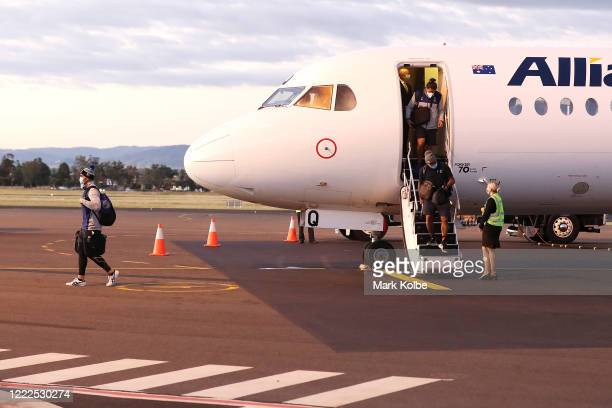 The New Zealand Warriors leave the plane as they arrive at Tamworth regional Airport on May 03, 2020 in Tamworth, Australia. The Warriors have been...