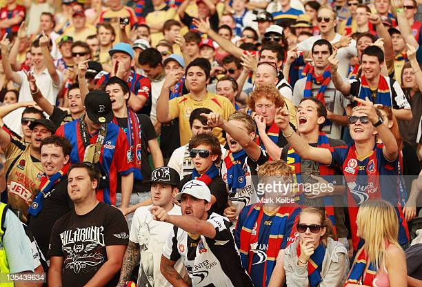 The Newcastle Jets supporter in the crowd yell at the players during the round 10 ALeague match between the Central Coast Mariners and the Newcastle...
