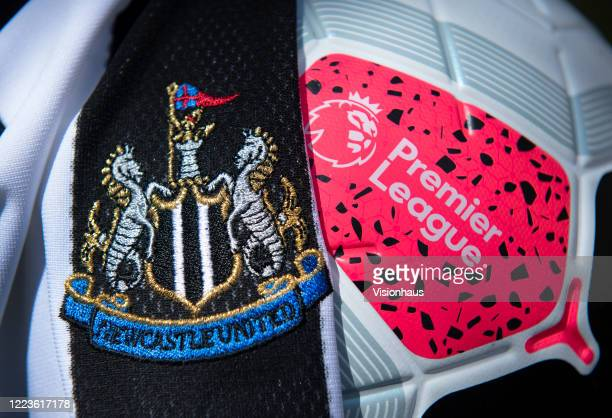 The Newcastle United club crest on the first team home shirt displayed with a Premier League match ball on May 5, 2020 in Manchester, England