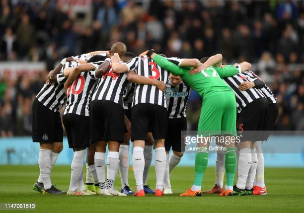 The Newcastle United team get into a huddle before kickoff during the Premier League match between Newcastle United and Liverpool FC at St James Park...