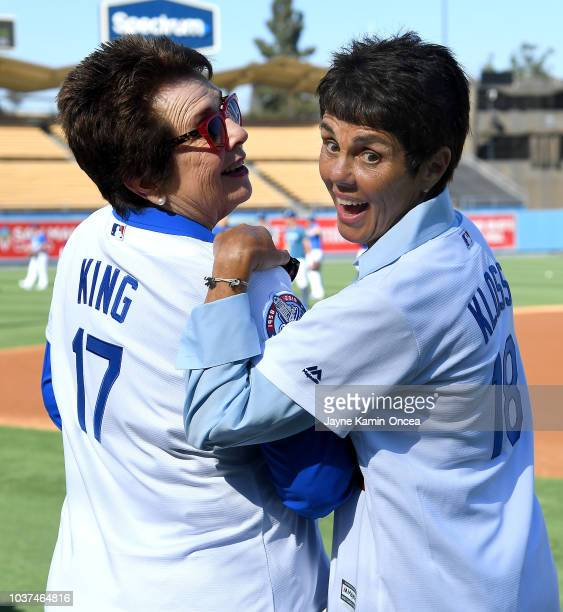 The newest members of the Los Angeles Dodgers ownership group Billie Jean King and Ilana Kloss show off their jerseys on the field before the game...