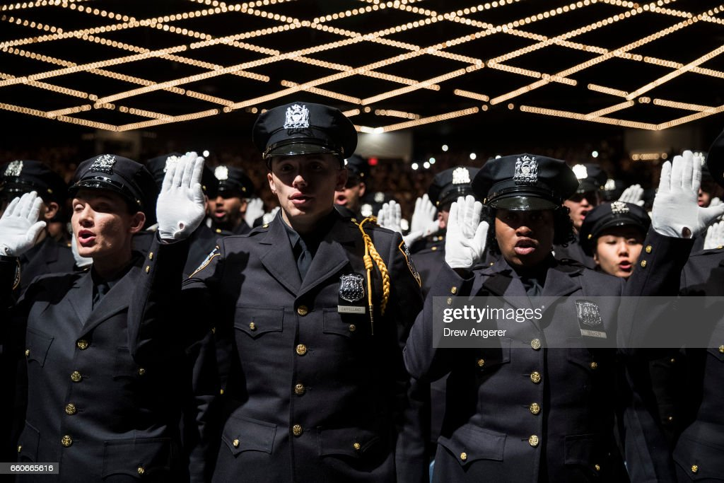 The newest members of the New York City Police Department (NYPD) are sworn-in during their police academy graduation ceremony at the Theater at Madison Square Garden, March 30, 2017 in New York City. Over 600 new officers were sworn in during the ceremony.