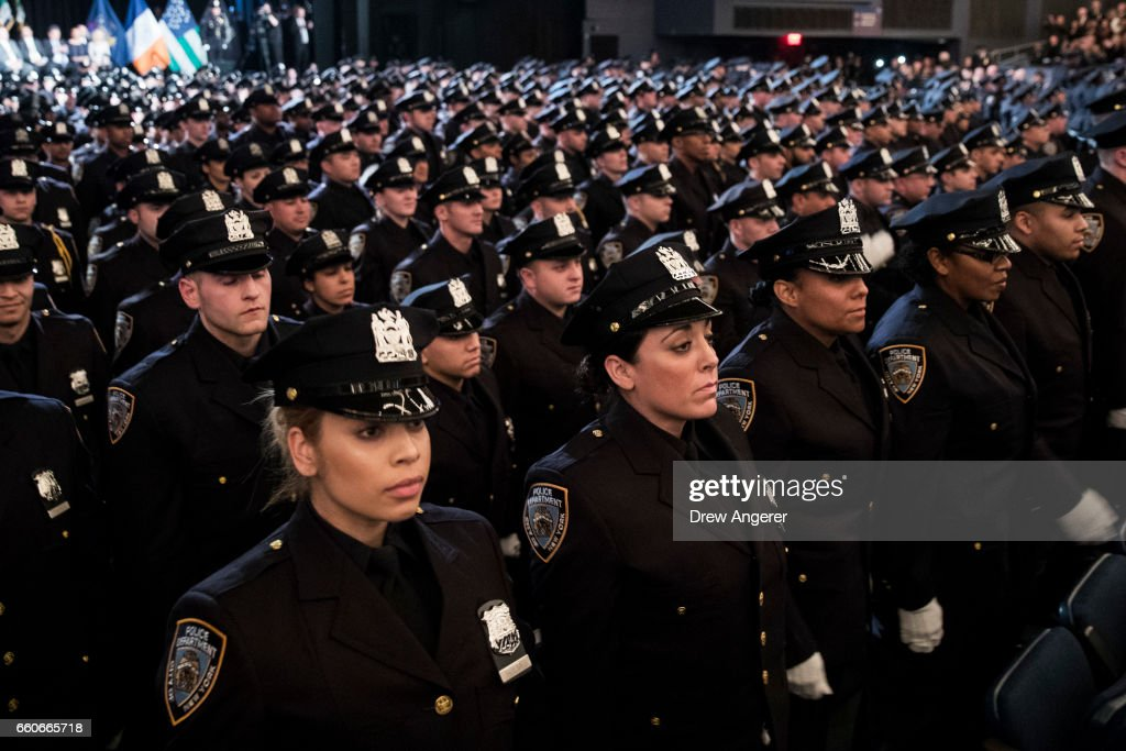 The newest members of the New York City Police Department (NYPD) attend their police academy graduation ceremony at the Theater at Madison Square Garden, March 30, 2017 in New York City. Over 600 new officers were sworn in during the ceremony.