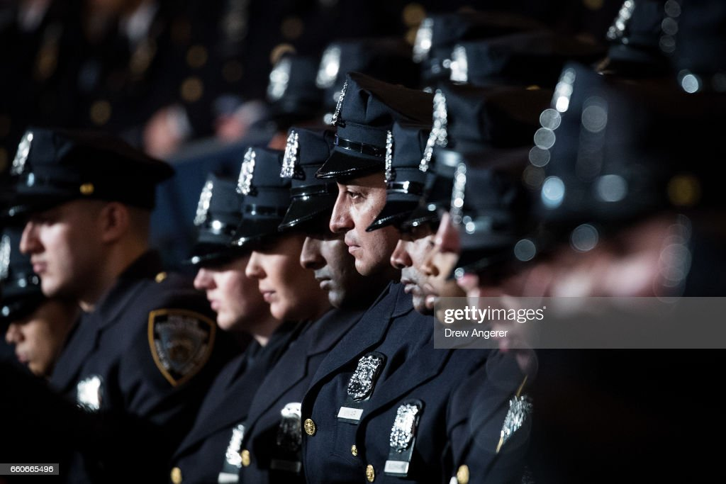 The newest members of the New York City Police Department (NYPD) listen to remarks from New York City Police Commissioner James O'Neill during their police academy graduation ceremony at the Theater at Madison Square Garden, March 30, 2017 in New York City. Over 600 new officers were sworn in during the ceremony.