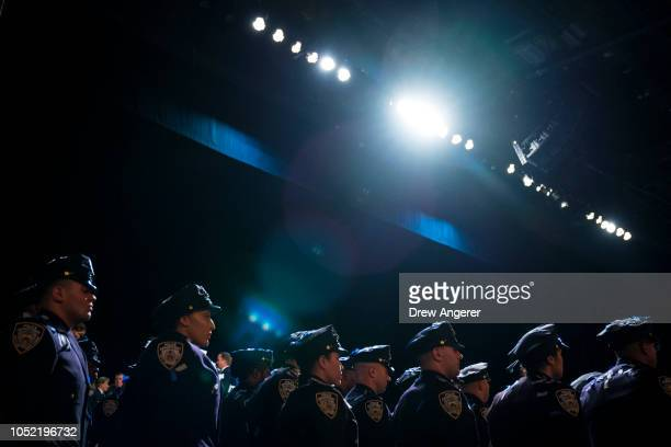 The newest members of the New York City Police Department prepare to exit at the conclusion of their police academy graduation ceremony at the...