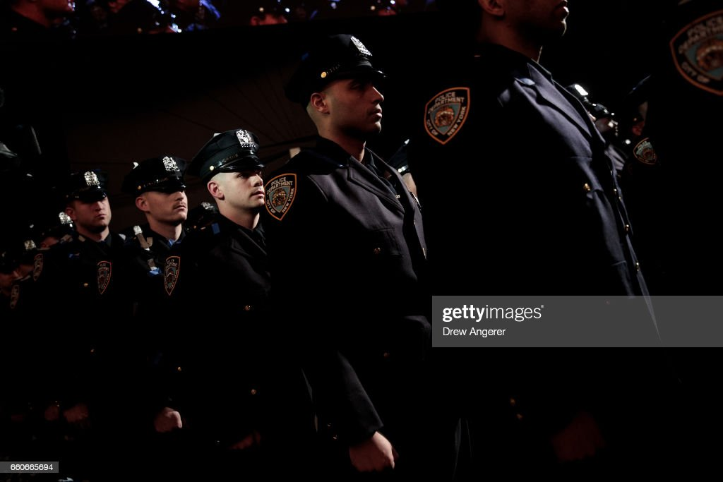 The newest members of the New York City Police Department (NYPD) prepare to exit at the conclusion of their police academy graduation ceremony at the Theater at Madison Square Garden, March 30, 2017 in New York City. Over 600 new officers were sworn in during the ceremony.