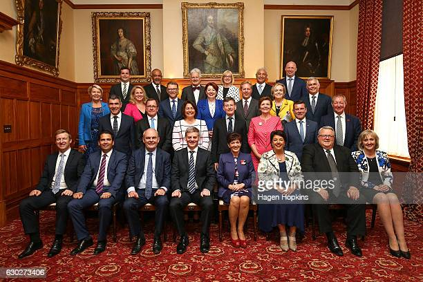 The newlook cabinet pose for a group photo during a ceremony at Government House on December 20 2016 in Wellington New Zealand Bill English announced...