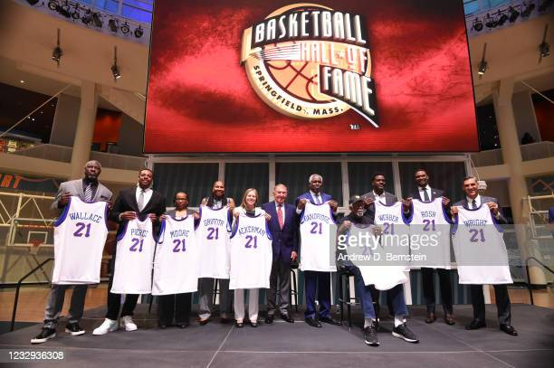 The newly announced Class of 2021 honorees poses for a group photo during the opening of the newly renovated Naismith Memorial Basketball Hall of...