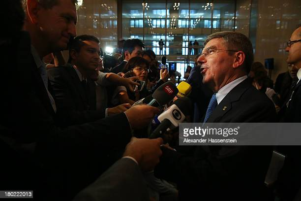The newly announced ninth IOC President Thomas Bach is interviewed in the mixed zone during the 125th IOC Session - IOC Presidential Election at the...