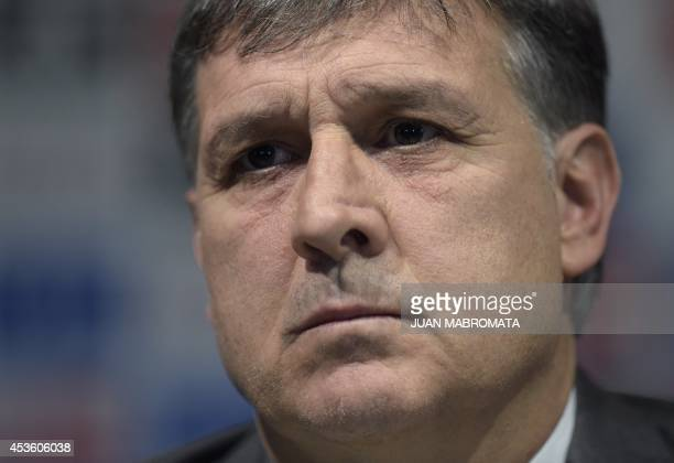 The newly appointed Argentina's football squad coach Gerardo Martino gestures during a press conference in Ezeiza Buenos Aires Argentina on August 14...