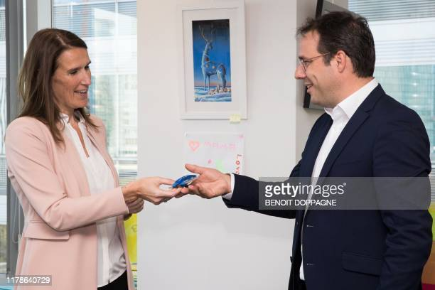 The newly appointed Belgian Prime Minister Sophie Wilmes and the newly appointed Minister of Budget Civil Services and Science David Clarinval attend...