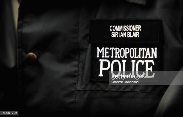 The Newly appointed Commissioner of the Metropolitan Police Sir Ian Blair's ID badge is seen on his coat as he visits a housing estate in Chelsea on...