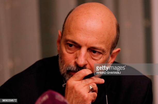 The newly appointed Jordanian Prime Minister Omar alRazzaz meets with member of Union leaders in Amman on June 7 2018 AlRazzaz said that a deal has...
