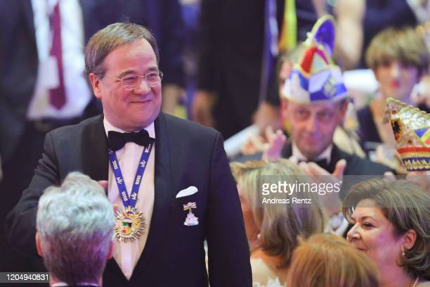 The newly appointed knight Armin Laschet Deputy coChairman of the German Christian Democrats and Governor of North RhineWestphalia gestures while...