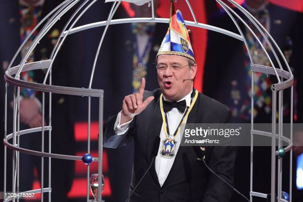 The newly appointed knight Armin Laschet, Deputy co-Chairman of the German Christian Democrats and Governor of North Rhine-Westphalia, gestures...