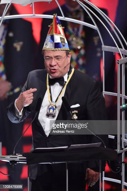 The newly appointed knight Armin Laschet Deputy coChairman of the German Christian Democrats and Governor of North RhineWestphalia gestures during...