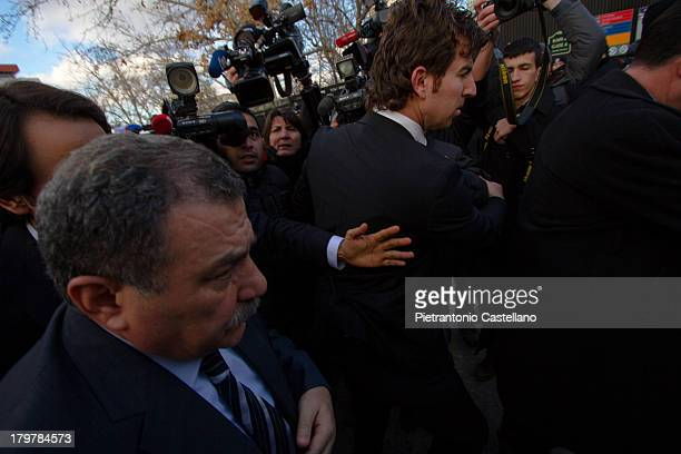 The newly appointed Minister of Interior Muammer Güler arrives at the scene of the suicide bombing at the U.S. Embassy in Ankara.