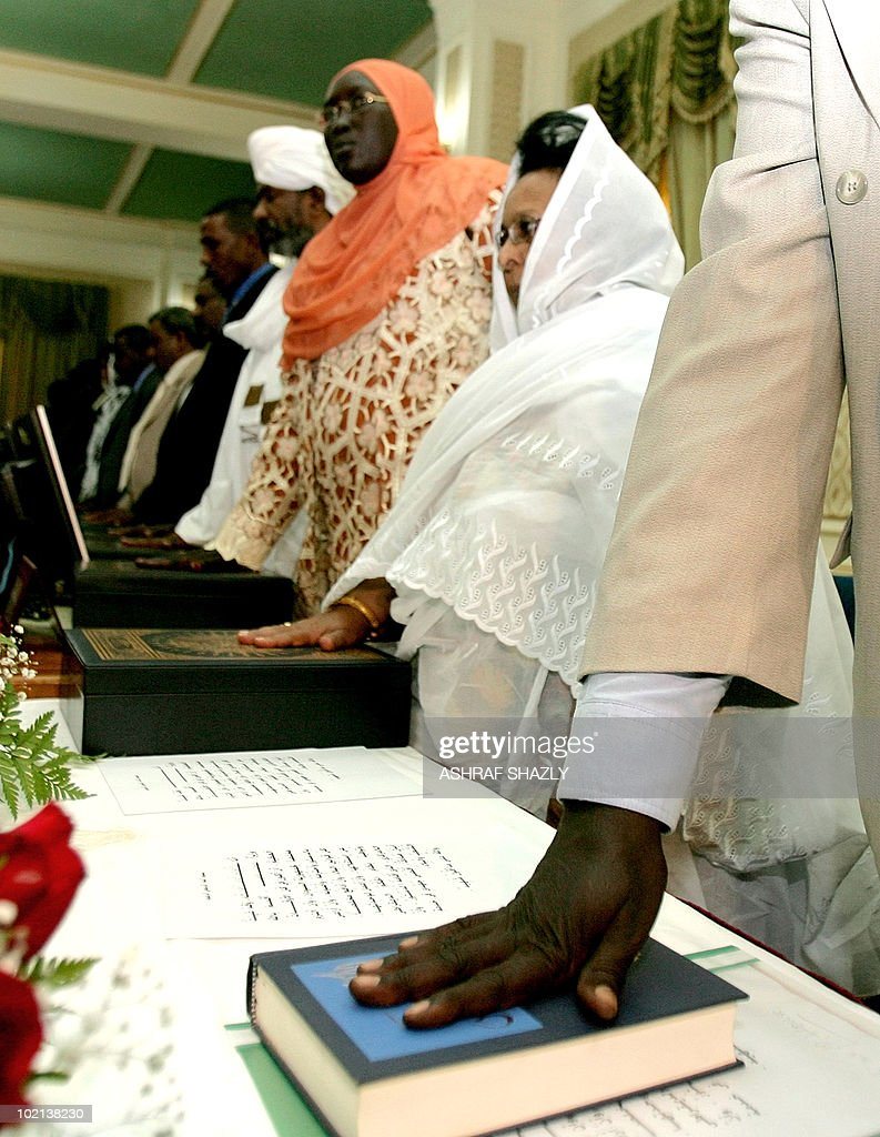 The newly appointed Sudanese ministers are sworn in on June 16, 2010, in Khartoum as the new government, consisting of 24 members of the president's National Congress Party, eight members of the former southern rebel Sudan People's Liberation Movement and three small parties, must tread carefully to reach the key referendum on independence for south Sudan scheduled for January.
