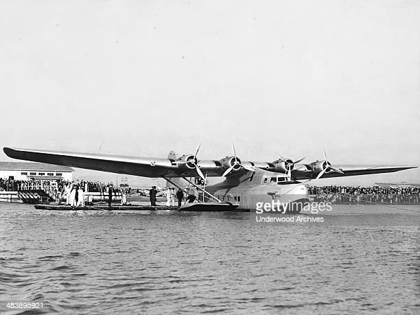 The newly arrived China Clipper seaplane which will make the inaugural flight of Pan American Airways' transpacific service to Manila Alameda...