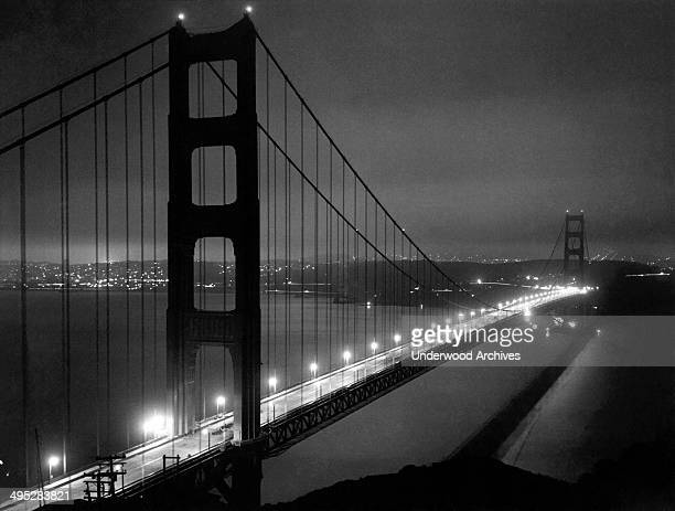 The newly completed Golden Gate Bridge at night waiting for its grand opening in two more days San Francisco California May 25 1937
