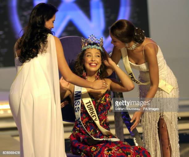 The newly crowned Miss World Miss Turkey Azra Akin with runner up Miss Colombia Natalie Peralta and Miss Peru Marina Mora Montero at Alexandra Palace...
