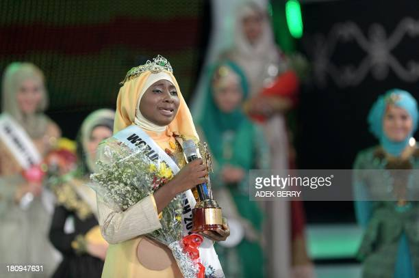 The newly crowned Muslimah World 2013 Obabiyi Aishah Ajibola of Nigeria speaks to the audience during the Muslimah World competition in Jakarta on...