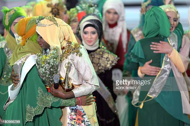 The newly crowned the Muslimah World 2013 Obabiyi Aishah Ajibola of Nigeria is congratulated by others contestants during the Muslimah World...
