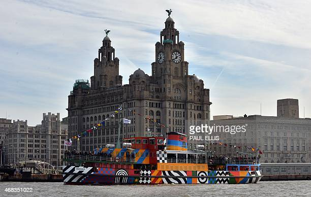 The newly decorated Mersey Ferry 'Snowdrop' painted to a design by artist Sir Peter Blake is seen in the River Mersey in front of the Liver Building...