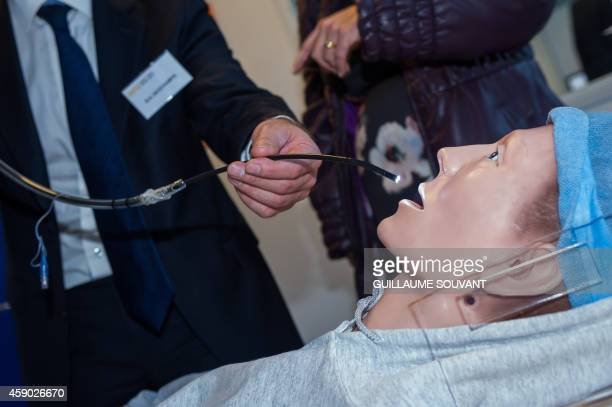 The newly devised disposable endoscope invented and produced by the French company Axess Vision Technology is shown to the press on November 15 2014...