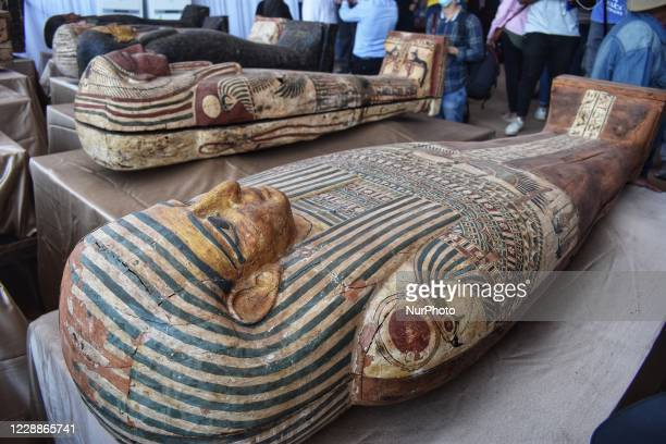 The newly discovered coloured ancient intact and sealed coffins are displayed during a press conference to announce new archaeological discovery 59...