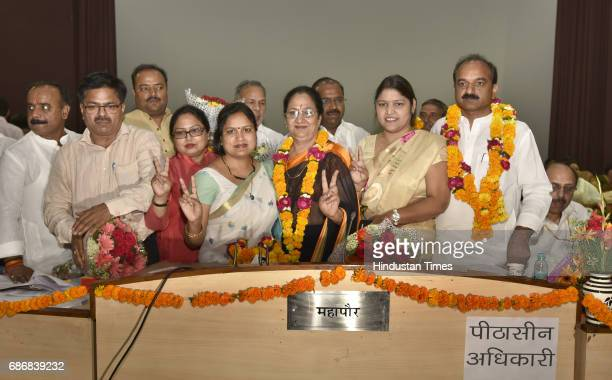 The Newly elected Mayor of East Delhi Municipal Corporation Neema Bhagat and Deputy Mayor Bipin Bihari Singh along with others after the election at...