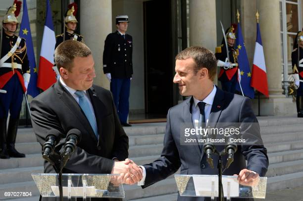 The newly elected president of France Emmanuel Macron receives Prime Minister Juri Ratas of Estonia at the Elysée Palace on June 16 2017 in Paris...