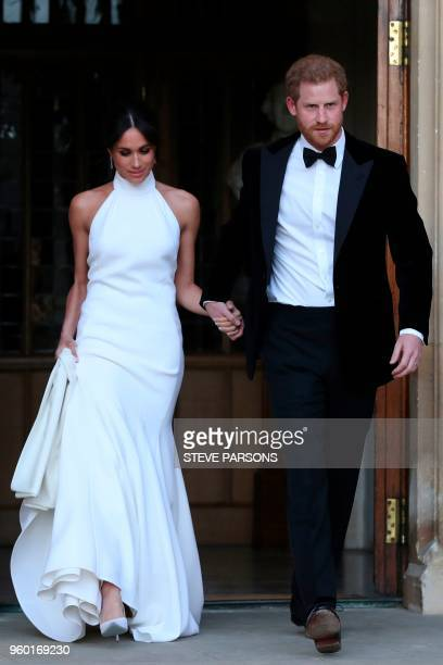 The newly married Britain's Prince Harry Duke of Sussex and Meghan Markle Duchess of Sussex leave Windsor Castle in Windsor on May 19 2018 after...