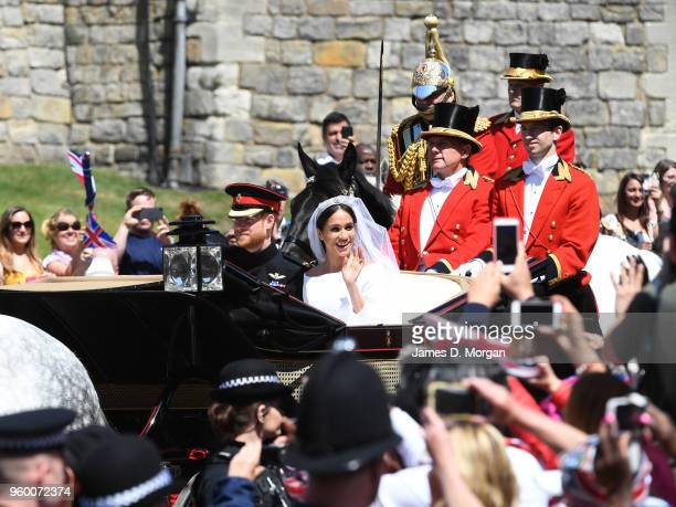 The newly married Duke and Duchess of Sussex depart Windsor Castle in the Ascot Landau carriage during the procession after getting married St...