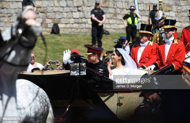 The newly married Duke and Duchess of Sussex departing the castle in the Ascot Landau carriage during the procession after getting married at St...