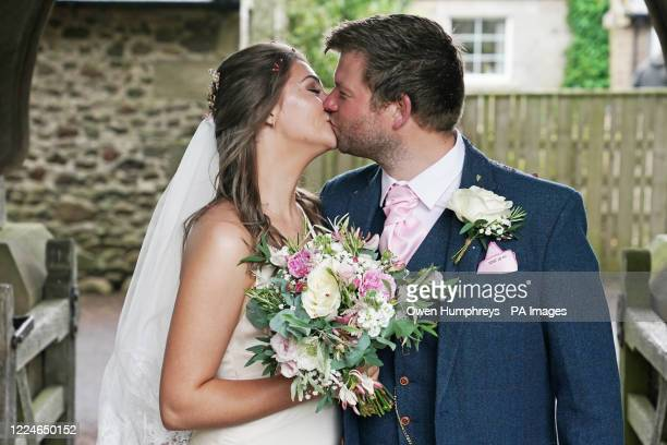 The newly married Mr and Mrs Bone, Lucy and James, after their wedding at St Michael and all Angels Church in Ingram, Northumberland, as weddings are...