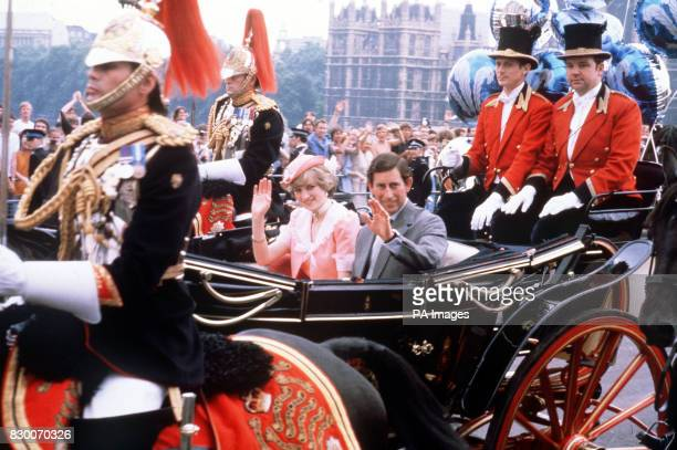The newly married Prince and Princess of Wale wave to the London crowds from their opentop carriage as they make their way to Waterloo Station to...