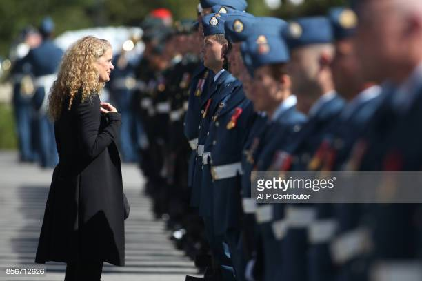 The newly sworn in Governor General Julie Payette inspects the honour guard on Parliament Hill in Ottawa, Ontario, October 2, 2017. Former astronaut...
