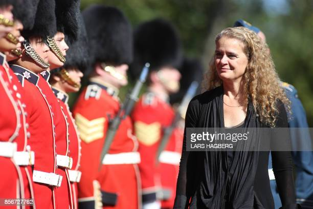 The newly sworn in Governor general Julie Payette inspects the honour guard at Rideau hall in Ottawa, Ontario, October 2, 2017. - Former astronaut...