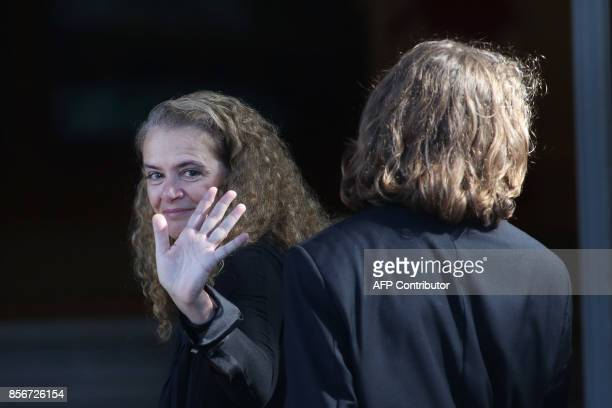 The newly sworn in Governor General Julie Payette waves as she and her son Laurier Payette Flynn enters Rideau hall in Ottawa, Ontario, October 2,...