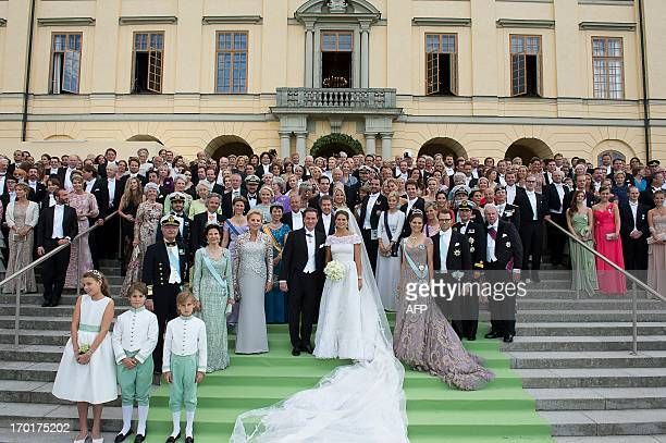 The newly wed Princess Madeleine of Sweden and Christopher O´Neill pose with families and guests in front of the Drottningholm castle on June 8 2013...