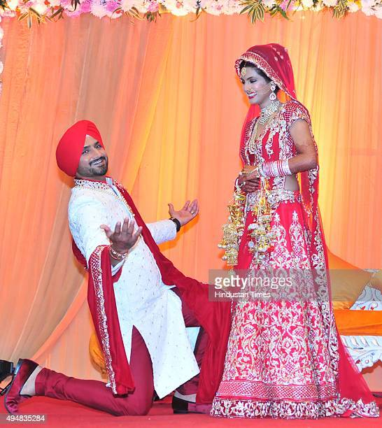 The newly wedded couple Indian cricketer Harbhajan Singh got on his knees with wide open arms like Bollywood actor Shah Rukh Khan for actress wife...