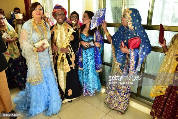 The newly weds are serenedaded by guests as they emerge together during a traditional wedding ceremony at the home of the bride in Moroni July 28...