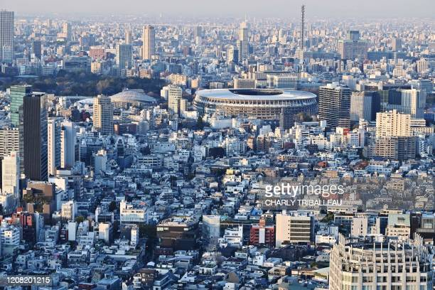 The newly-built Japan National Stadium, the main venue for the 2020 Olympic Games, is pictured from a highrise viewing area in Tokyo on March 25 the...