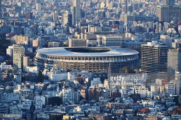 The newlybuilt Japan National Stadium the main venue for the 2020 Olympic Games is pictured from a highrise viewing area in Tokyo on March 25 the day...