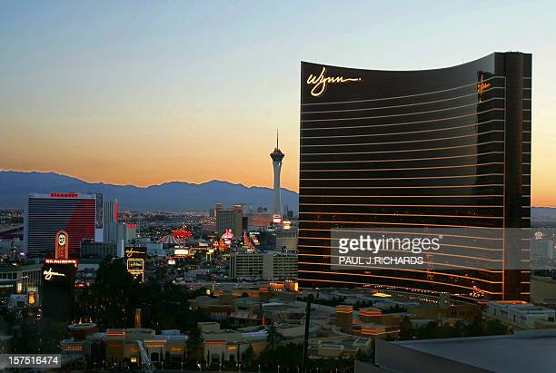 The newlyopened Wynn Hotel towers above the city as the sun rises over Las Vegas, Nevada 03 May 2005 . AFP Photo/Paul J. RICHARDS