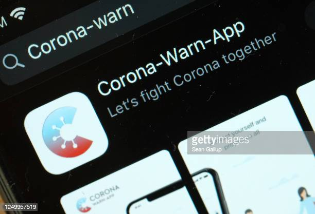 The newlyreleased CoronaWarnApp developed by the German government for tracing Covid19 infections is seen for download on an Apple iPhone during the...