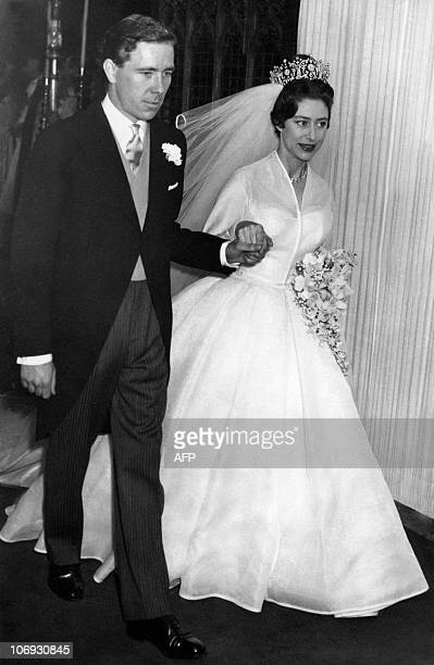 The newlywed Princess Margaret the younger sister of Britain's Queen Elizabeth II leaves hand in hand with her husband the photographer Antony...