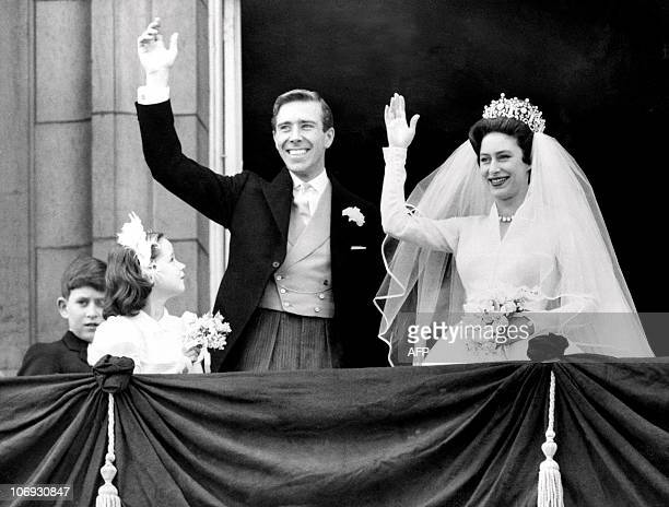 The newlywed Princess Margaret the younger sister of Britain's Queen Elizabeth II and her husband the photographer Antony ArmstrongJones wave 06 May...